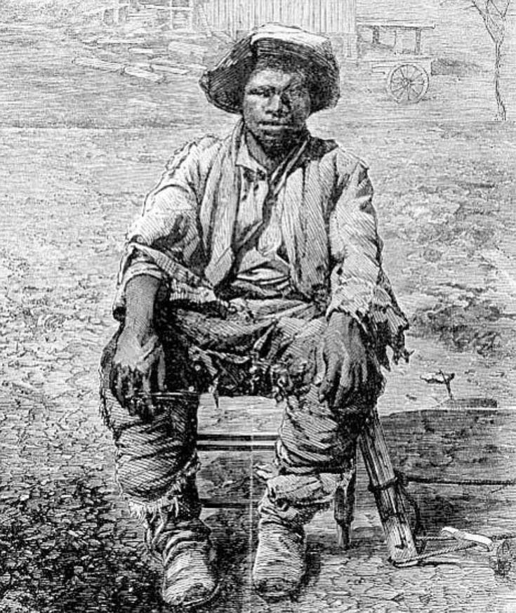 Black American man sitting in a farm setting