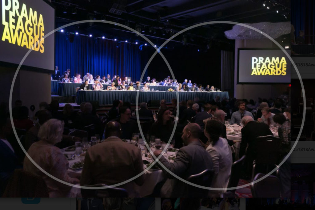 Wide shot of Drama League Awards event, two screens show graphic for Drama League Awards