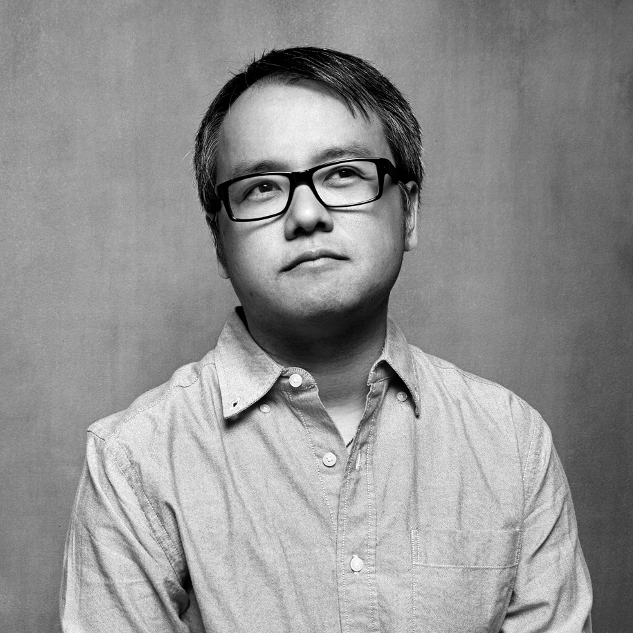 Qui Nguyen, black and white photo with glasses and short dark hair